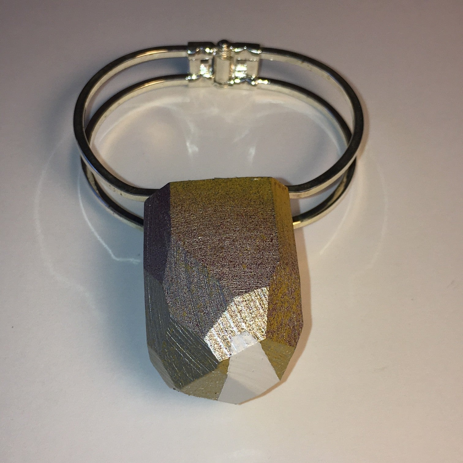 silver cuff with tall faceted wood multi color