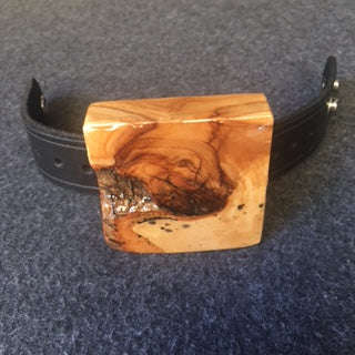 black leather bracelet with chunk of natural wood
