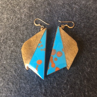 blue with orange dot triangles , and champagn