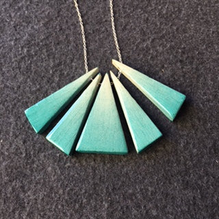 5 piece bluegreen and white, wood on other side