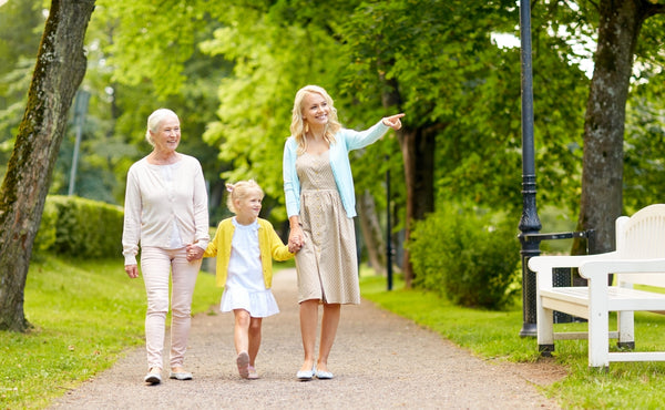 celebrate mother's day strolling with mother in a park