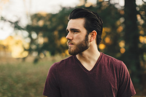 A man with a soft beard looking into the distance.