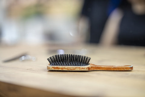 A brush lying on a wooden table