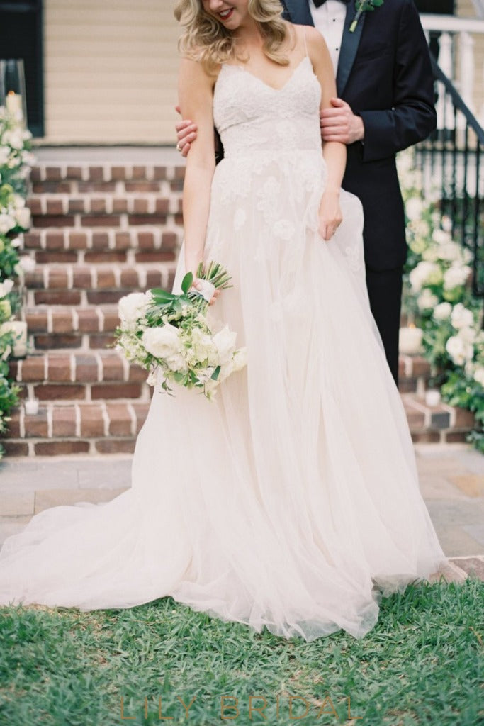 wedding dress silhouette with lace appliqued bodice