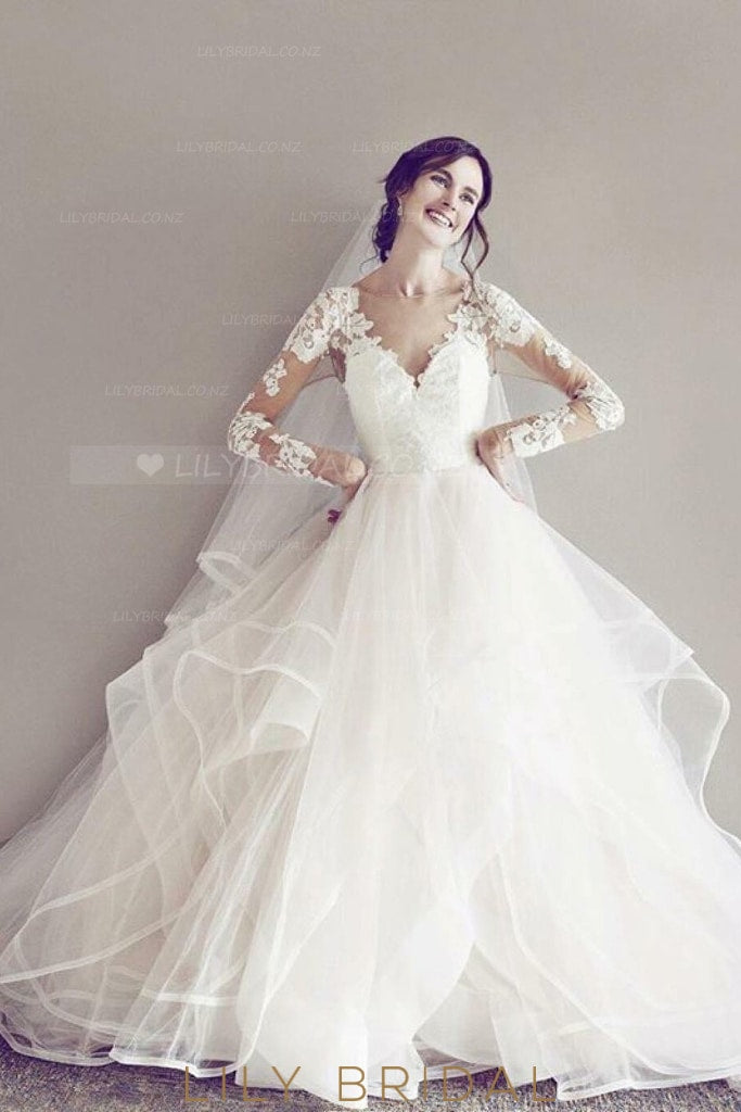 Ball Gown Long Sleeve Keyhole Back Tiered Ruffle Tulle Wedding Dress With Sheer Lace Bodice