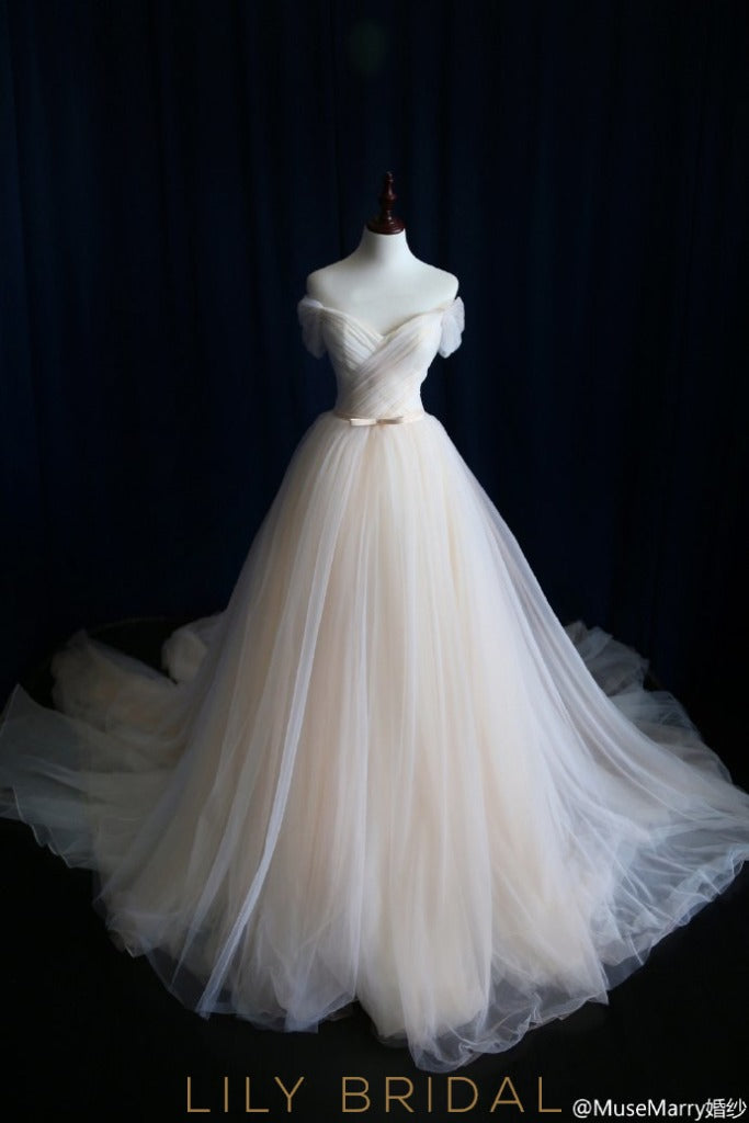 champagne tulle off the shoulder wedding dress