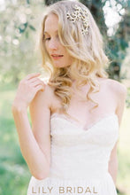 a line long wedding dress with strapless empire waist
