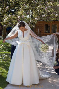 Bow-knot Bateau Neck Sleeveless Backless Long Solid Wedding Gown with Sweep Train