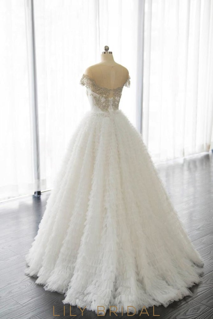 gold embroidered tiered tulle ball gown wedding dress
