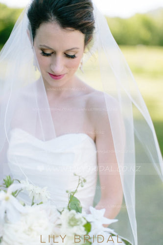 One Tier Hip Length Bridal Veil With Satin Ribbon Edge