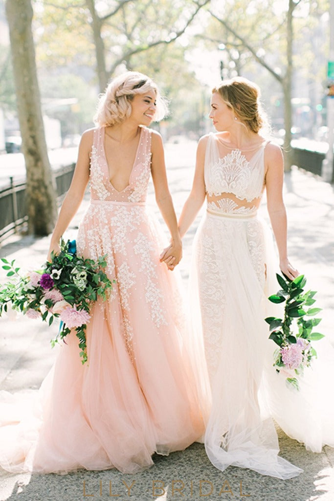 pink a line tulle plunging sleeveless wedding dress