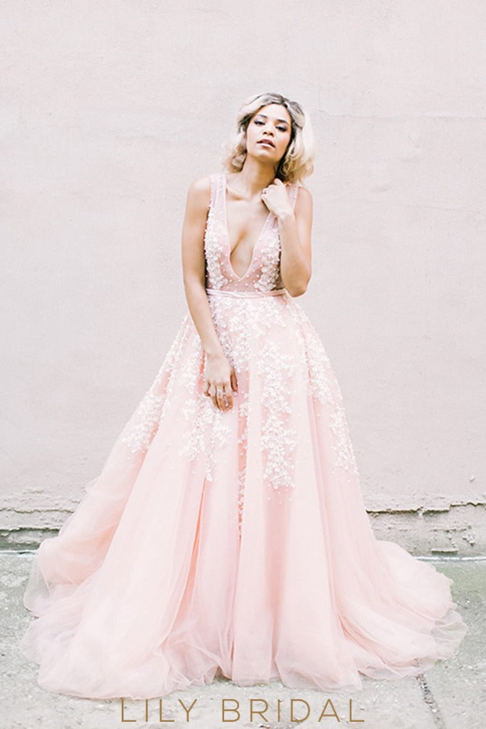 pink a line tulle plunging pearls wedding dress