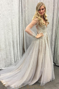 Sheer Long Sleeve Plunging V-Neckline Tulle Champagne Sequinned Prom Dress
