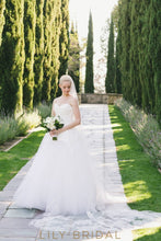 sleeveless plunging v neckline illusion back ivory wedding dress