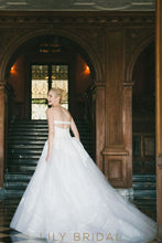 sleeveless plunging wedding dress
