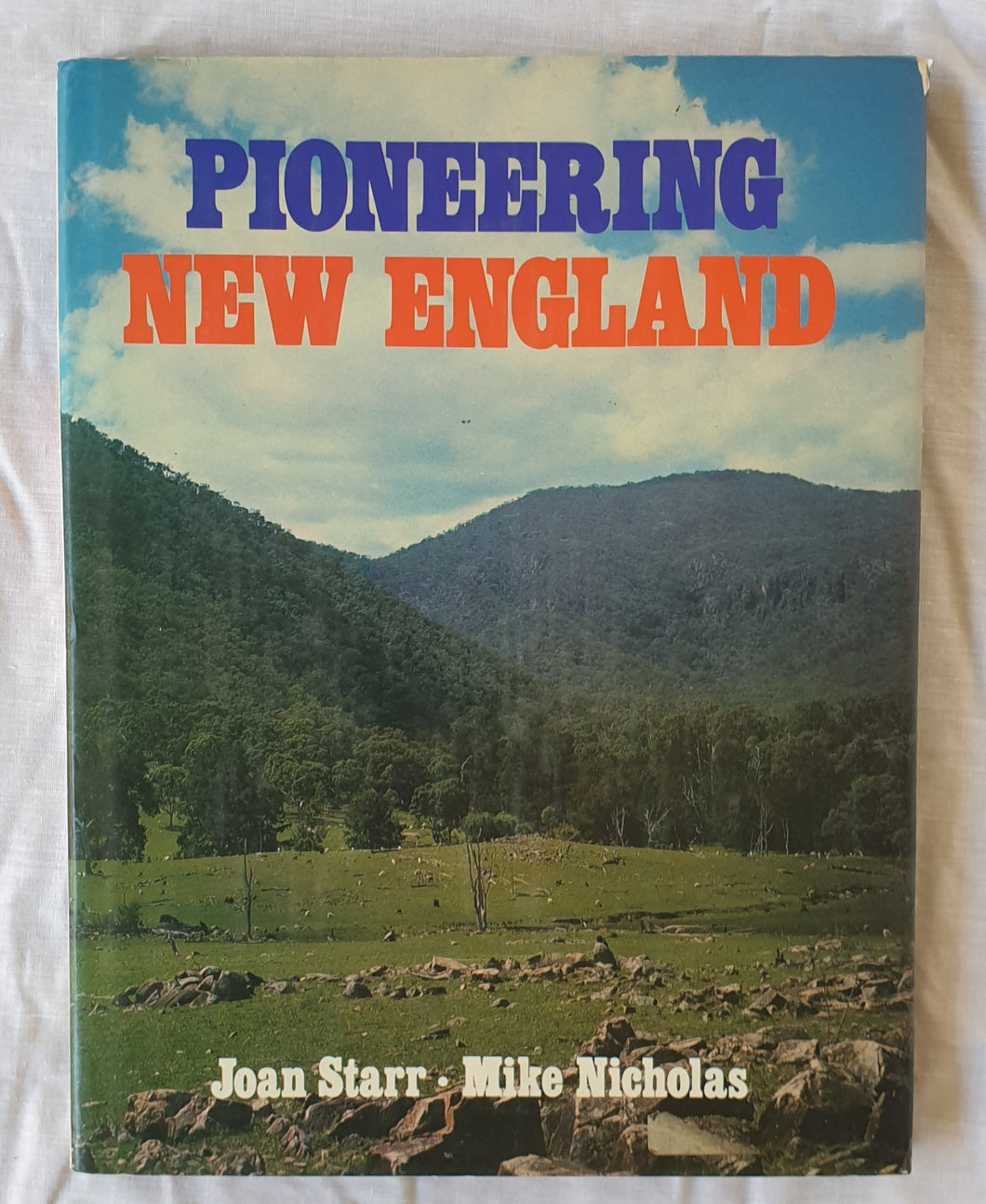 Pioneering New England  Text by Joan Starr  Illustrated by Michael Nicholas
