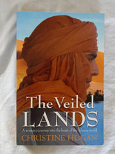 Load image into Gallery viewer, The Veiled Lands  A woman's journey into the heart of the Islamic world  by Christine Hogan
