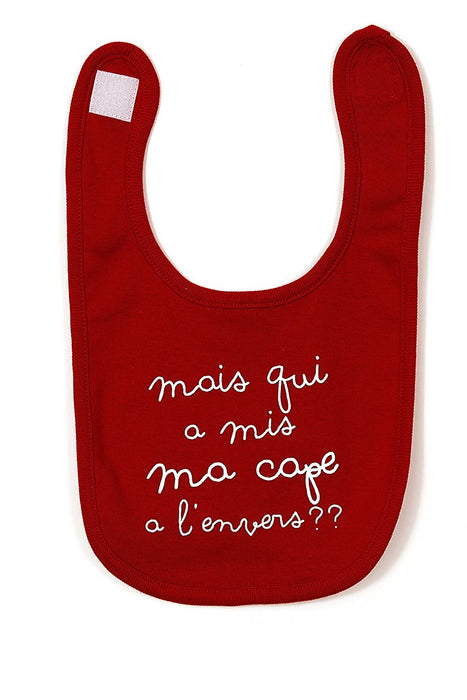 BB&co Bib with French Text 'Mais Qui à Mis Ma Cape à l'Envers' (But Who Put On My Cape Back To Front?) Red