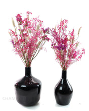 Dried Flowers in a Black Glass Vase