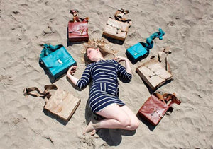 Coterie Leather Bags - girl with bag collection on beach