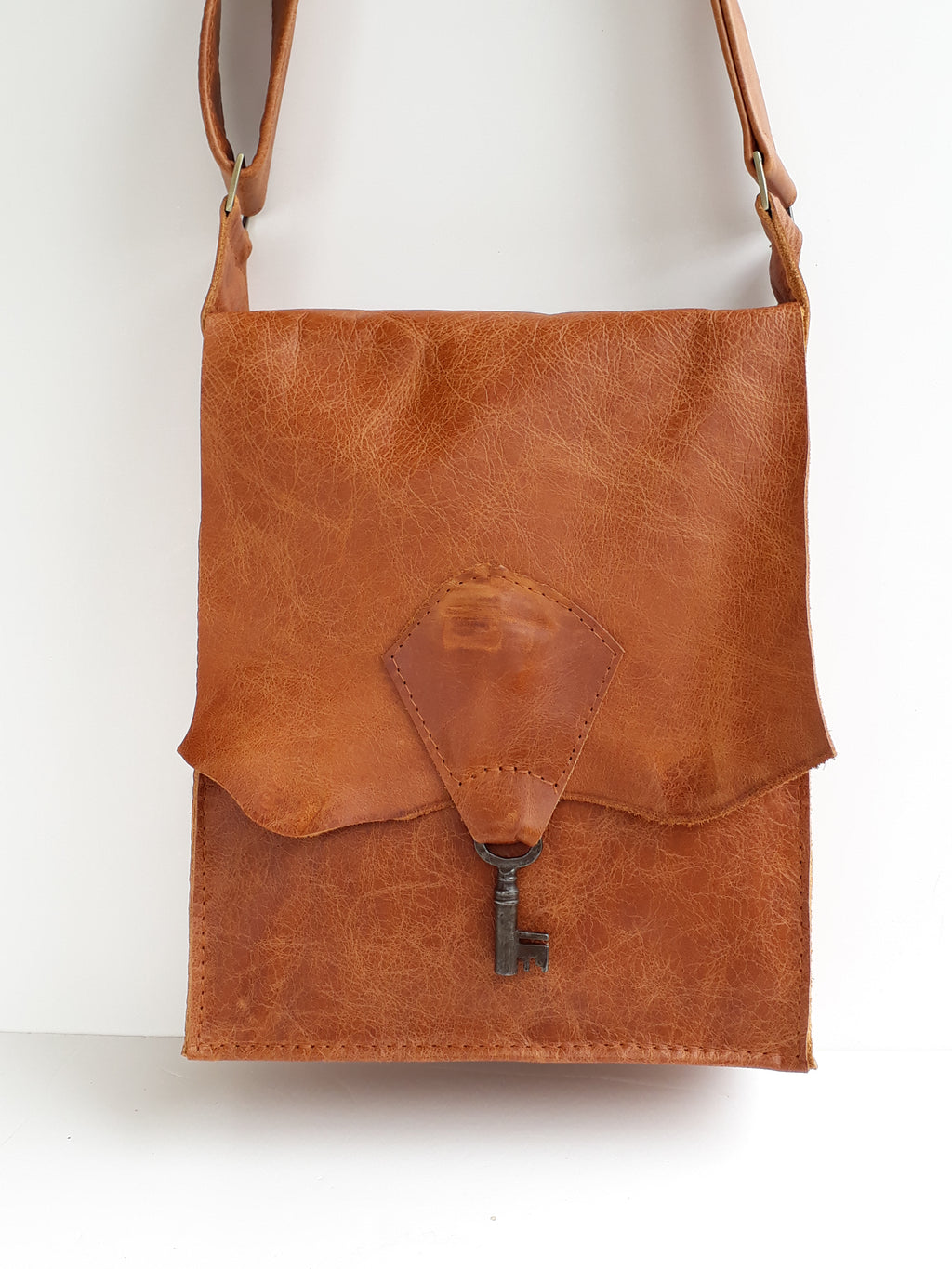 Raw Edge Leather Bag with Vintage Key Detail - Tan - Coterie Leather Bags