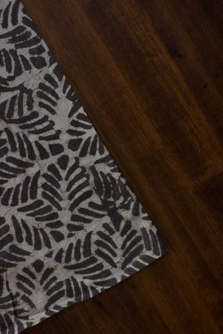Leaves in grey dabu print fabric