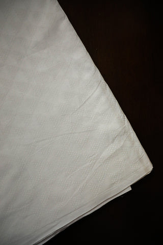 Off White Dotted Triangle Block Printed Cotton Fabric