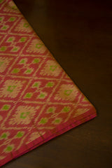 Pinkish Peach with Green Ikat Silk Cotton Fabric