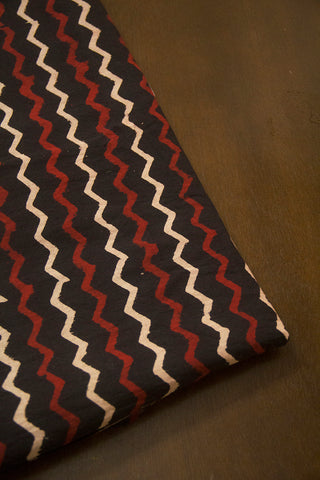 Black with Maroon and Beige Zig Zag Ajrak Cotton Fabric