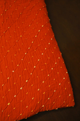 Reddish Orange Bandhani Cotton Fabric