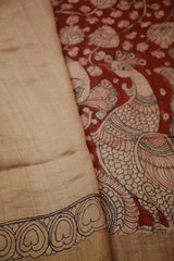 Intricate Peacocks in natural red Tussar Silk Kalamkari Saree