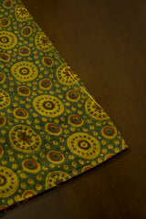 Green with Yellow Circles Malai Cotton Fabric