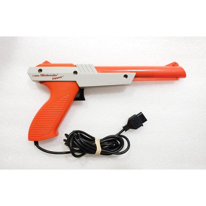 Nintendo NES Zapper Light Gun - Orange - YourGamingShop.com - Buy, Sell, Trade Video Games Online. 120 Day Warranty. Satisfaction Guaranteed.