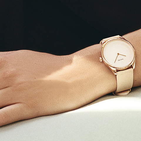 minimal watches for women with double-domed crystal case