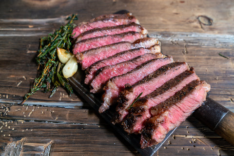 New York Strip Steak cut into slices after cooked in a cast iron skillet