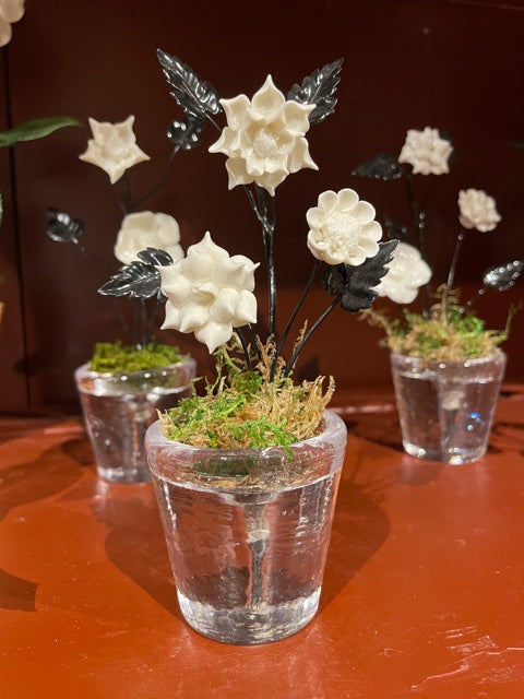Handpainted White Porcelain Pensees with Black Tole Leaves and Stems in Clear Glass Pot