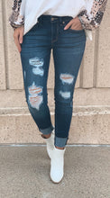 High-Rise Distressed Skinny Jeans