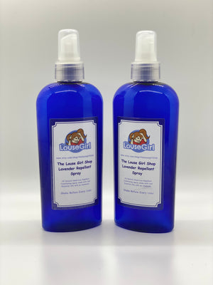 Two Tea Tree Oil Repellent Spray bottles that repels against head lice.