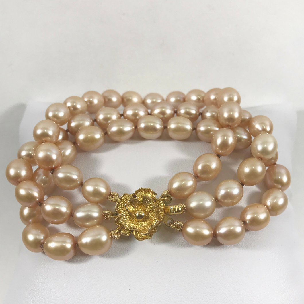 Tripple Gold Pearl Knotted Bracelet & Gold Flower Clasp