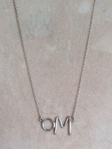 Sterling silver Om necklace with little O