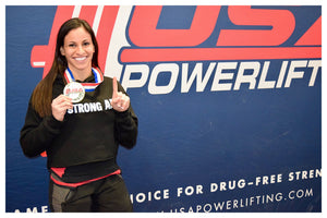 Powerlifter Kate Cohen with her Gold meal and Strong AF cropped hoodie