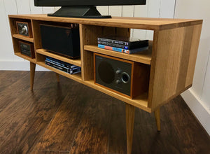 Mid century minimalist TV and video console, shown in quartersawn white oak.