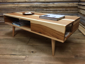 Mid century modern coffee table with storage, shown in solid hickory.