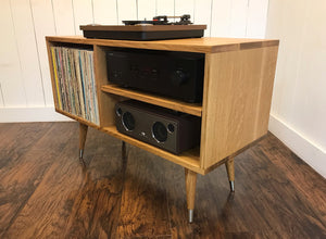 Quartersawn white oak turntable and stereo console with album storage.