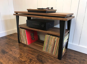 Walnut stereo and turntable console with album storage.