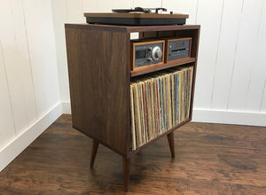 Solid walnut stereo console with album storage.