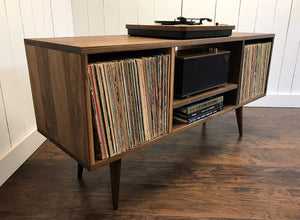 Solid walnut turntable and stereo console with album storage.