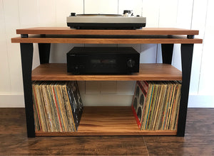 Mahogany stereo and turntable console with album storage.