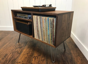 Solid walnut record player and stereo cabinet with album storage.