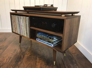 Solid walnut stereo and turntable cabinet with isolation platform.
